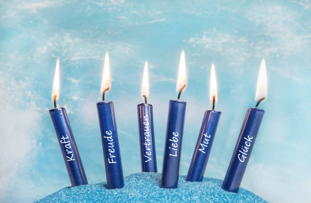 rituals: Six blue candles for a relaxation concept at spa or rituals for a greeting card. Stock Photo