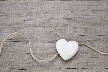 congratulation card: Wooden background with a white heart for wedding or valentines day. Stock Photo