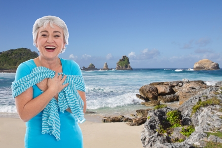 guadeloupe: Older woman on holiday on the sea - blue ocean