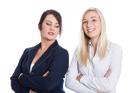 folding arms: Success: two satisfied business women smiling in business outfit folding arms on white background
