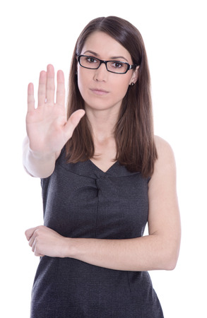 Isolated caucasian business woman says stop - concept for bullying. photo