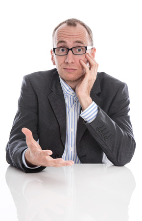 questioning: Isolated questioningly bald engineer or specialist sitting at desk