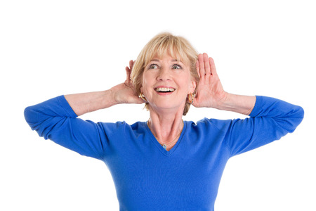 65 years old: Older woman hearing isolated on white