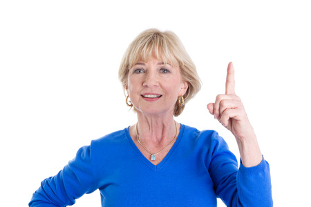 65 70: Mature woman showing index finger