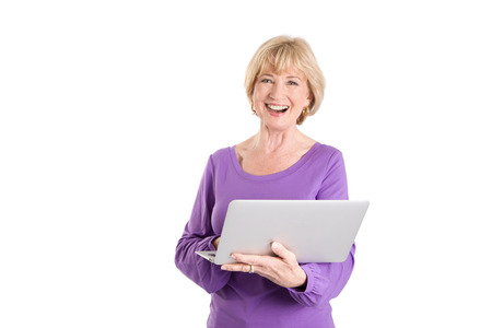Mature woman using laptop isolated on white