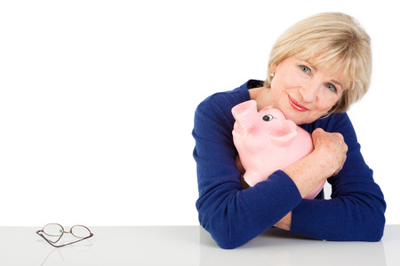 thrift box: Senior woman with piggy bank