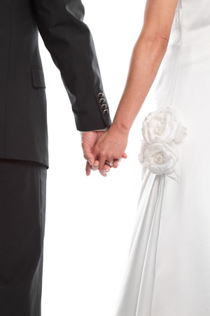 Wedding couple Holding Hands - isolated on White - marriage, wedding. photo