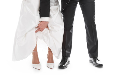 sexy bride: Wedding couple: Groom is showing brides feet, shoe, dress - wedding, marriage.  Stock Photo