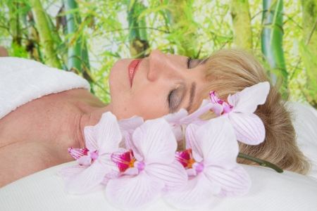 womanhood: Relaxed senior woman in spa