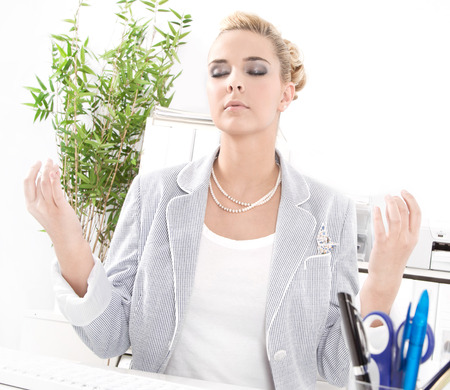 lunchbreak:  Meditation during the lunch break - business woman relaxes