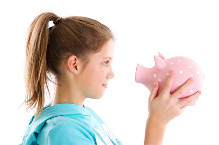 Isolated girl with piggy bank