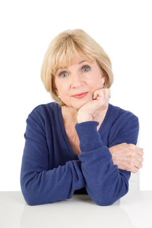 65 years old: Portrait of isolated elderly lady thinking