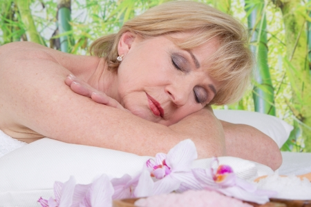 Relaxed elderly woman in spa  photo