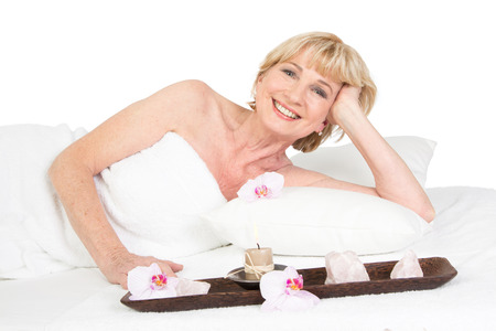 menopause: Happy mature lady at the Spa