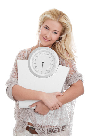 scale model:  Young blond woman with a scales in hand - isolated on white