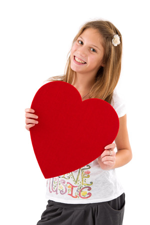 10 to 12 years: Isolated happy girl with heart on Mothers Day