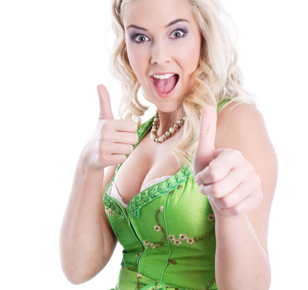 green thumb: Sexy bavarian blonde thumbs up, in a dirndl, for Oktoberfest, isolated on white Stock Photo