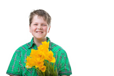 Boy with yellow tulips, isolated on white photo
