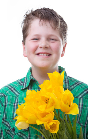 knave: Boy with yellow tulips, isolated on white Stock Photo