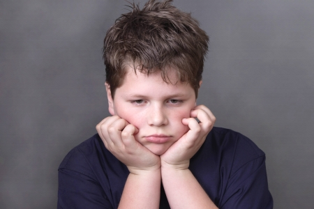 obese child: Portrait of unhappy tired boy