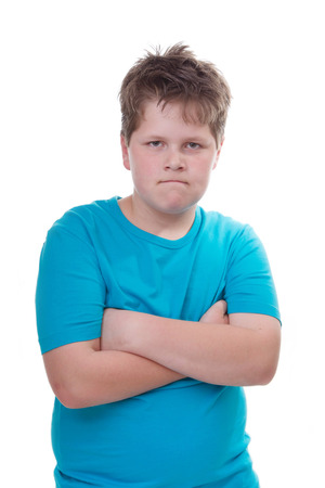 defiant: Isolated defiant boy in blue
