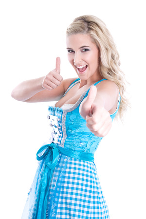 dirndl: Bavarian blonde thumbs up in a dirndl, isolated on white