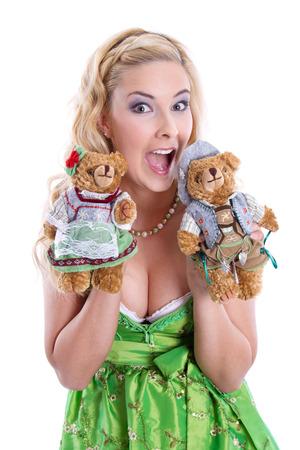 Bavarian Girl with teddy bears at Oktoberfest in Munich Stock Photo