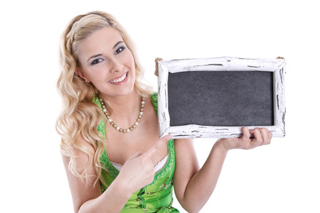 Bavarian girl in green dirndl with blank chalkboard, isolated on white Stock Photo - 24608950