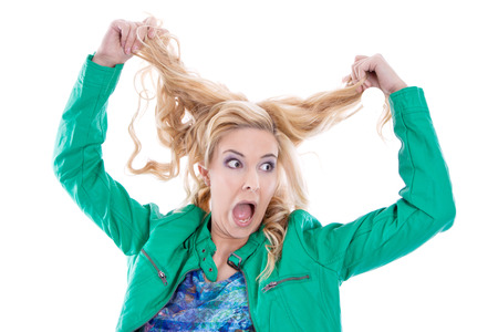 Shocked blond woman insane, in green, isolated on white photo