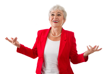 Happy isolated senior businesswoman in a red jacket isolated on white photo