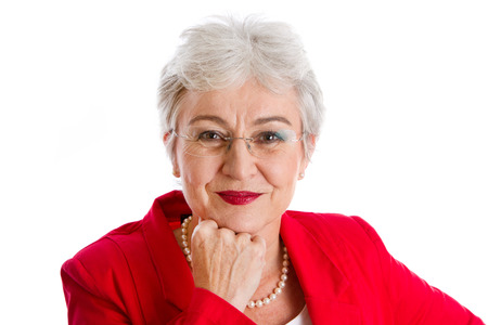 splendour: Portrait of a senior businesswoman isolated on white with a red jacket Stock Photo