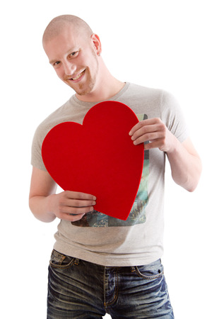 anniversary sexy: Man with red heart isolated on white