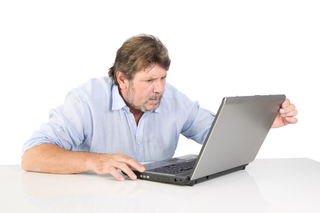 overburdened: Isolated retired rubbing his hands Stock Photo
