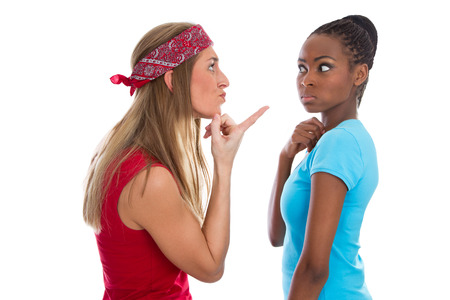 racism: Quarrel among women isolated on white.