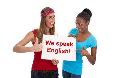 english text: 2 women - we speak English Stock Photo