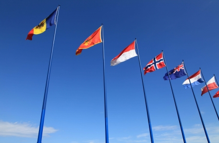 sky background with international flags photo