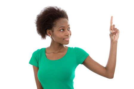 publicity: Young isolated african american in a green shirt pointing at something.