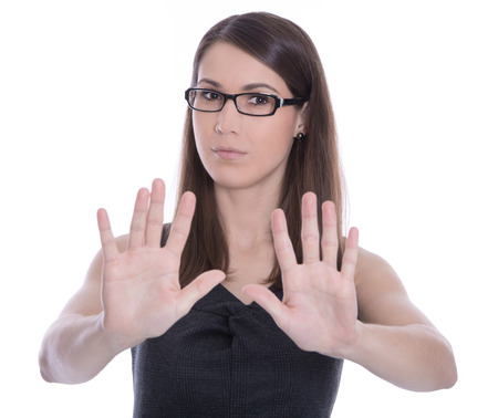 Isolated attractive business woman says stop - concept for bullying.