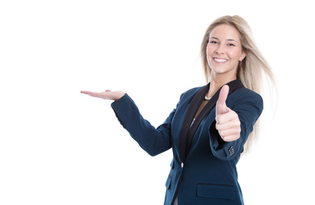 Smiling attractive woman presenting and thumb up  photo
