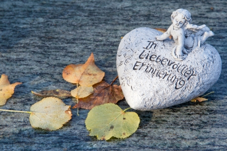 Grave ornament with heart of stone Stock Photo