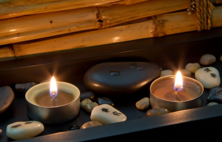 basalt: Romantic candlelight with chinese or asian characters - spa decoration with stones