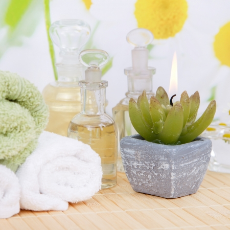 dangle: Wellness arrangement in white and yellow with oil and camomile Stock Photo