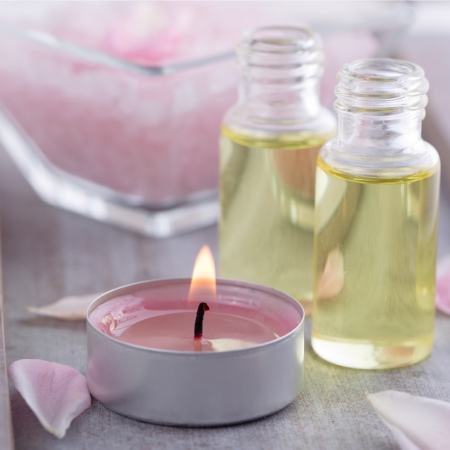 let out: Massage oil with pink candle - wellness decoration