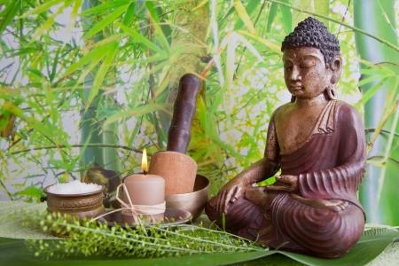 Buddha figurine with bath salt and a candle for spa Stock Photo - 24655260