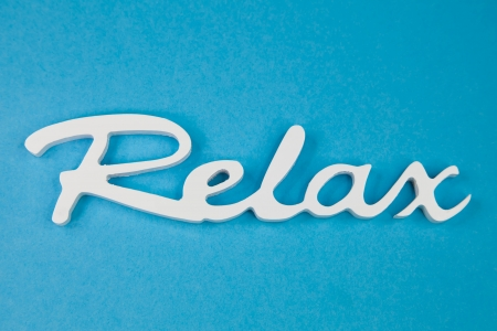 Word relax in white on a turquoise   Stock Photo - 24655339