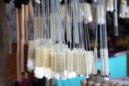 household goods: Different kinds of brushes on display in a household goods market Stock Photo