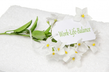 Wellness or spa concept for stressed people with a white towel and a sign for work-life-balance. Stock Photo - 24655155
