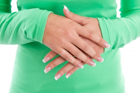 frenetic: Hands of a woman with French manicure