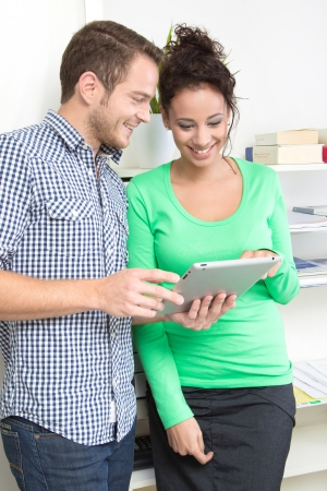 new media: Colleagues flirting in the office Stock Photo