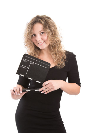 flap: Blonde woman posing with clapperboard isolated on white